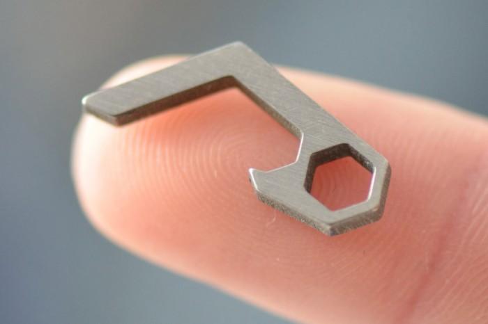 world s smallest bottle opener gear junkie. Black Bedroom Furniture Sets. Home Design Ideas