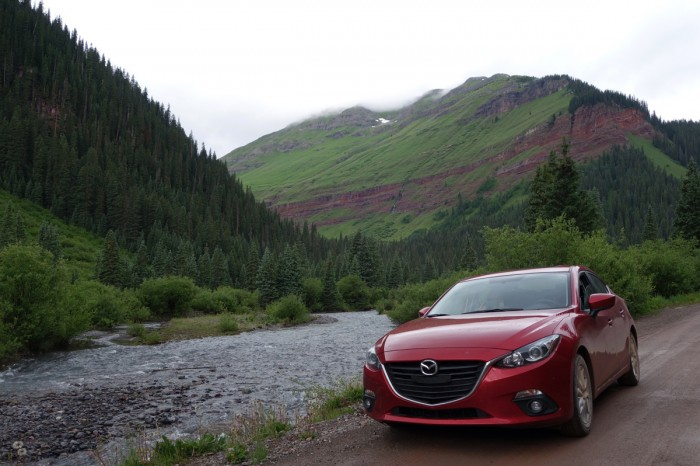Mazda3 on a forest road in San Juan National Forest.