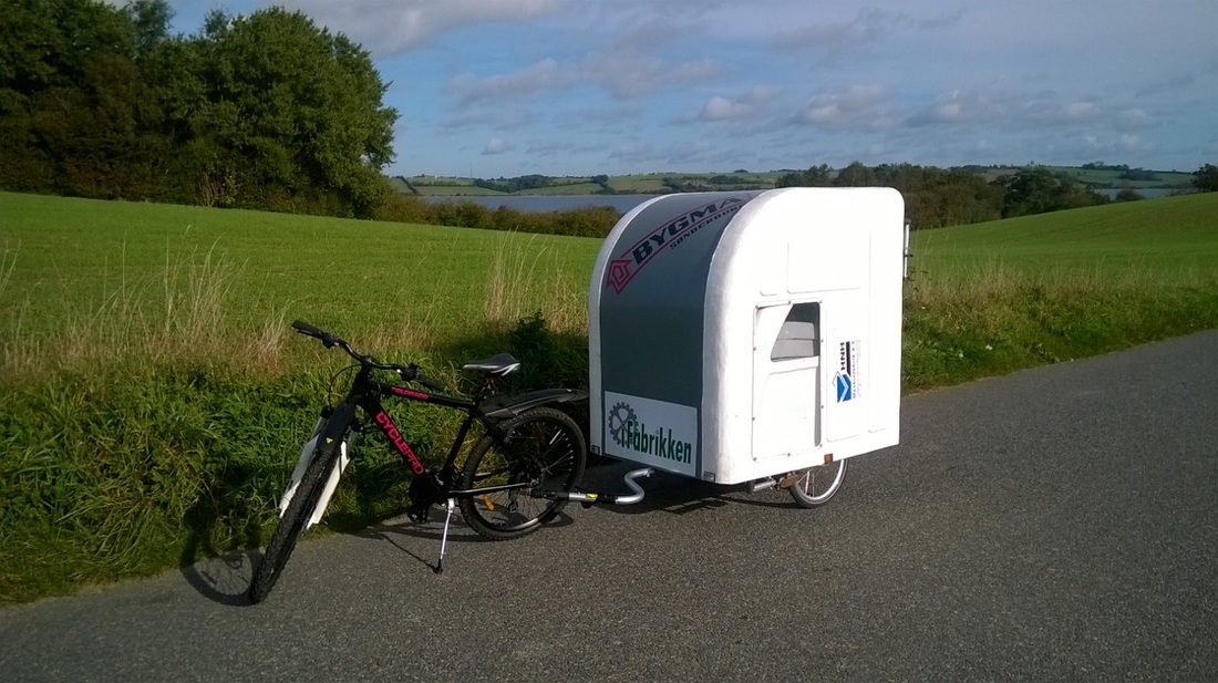 meet the camper made to pull behind your bike. Black Bedroom Furniture Sets. Home Design Ideas